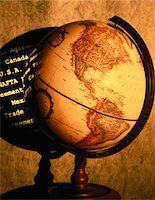 Antique globe, the Americas promin- ent, with trade agreement text Stock Photo - Premium Royalty-Freenull, Code: 6106-05586737