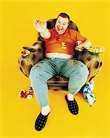 fat man full body - Portrait of a Couch Potato in An Armchair Stock Photo - Premium Royalty-Freenull, Code: 6106-05587330