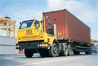 side view tractor trailer truck - Articulated Lorry Transporting a Cargo Container on a Road Stock Photo - Premium Royalty-Freenull, Code: 6106-05588638