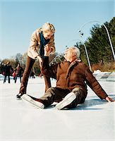 Mature Woman Holding the Hand of Mature Man and Helping Him Getting up From Ice Stock Photo - Premium Royalty-Freenull, Code: 6106-05589103