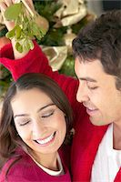 Couple Under the Mistletoe at Christmas Stock Photo - Premium Royalty-Freenull, Code: 6106-05592237