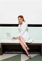 female white background full body - Portrait of a Well-Dressed Businesswoman Sitting on a Bench With a Laptop Stock Photo - Premium Royalty-Freenull, Code: 6106-05593124