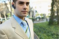 Smart Businessman Wearing a Hands-Free Device Stock Photo - Premium Royalty-Freenull, Code: 6106-05593574
