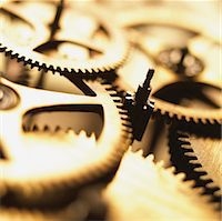Close up of interlocking Cogs in a Clockwork Mechanism Stock Photo - Premium Royalty-Freenull, Code: 6106-05594797