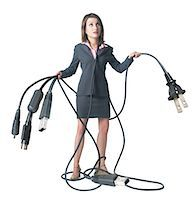 female white background full body - conceptual caricature of a caucasian business woman in a grey suit as she holds onto various equipment cords and cables Stock Photo - Premium Royalty-Freenull, Code: 6106-05595208