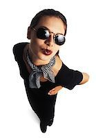 female white background full body - young adult female model in black dress and sunglasses puckers her lips and kisses up to the camera Stock Photo - Premium Royalty-Freenull, Code: 6106-05595404