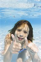 preteen girl - underwater lifestyle shot of a female child as she swims and gives the thumbs up in a pool Stock Photo - Premium Royalty-Freenull, Code: 6106-05595630