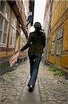 lifestyle shot of a young adult woman as she goes sightseeing on a european street Stock Photo - Premium Royalty-Free, Artist: Robert Harding Images, Code: 6106-05597213