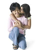 full length shot of a mother as she crouches down and is hugged by her daughter Stock Photo - Premium Royalty-Freenull, Code: 6106-05597490