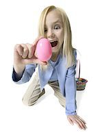 female white background full body - full body portrait of a female child as she acts excited after finding a pink easter egg Stock Photo - Premium Royalty-Freenull, Code: 6106-05598226