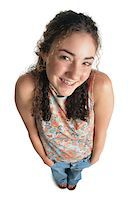 female white background full body - playful young caucasian teenage girl smiles while looking shyly into the camera Stock Photo - Premium Royalty-Freenull, Code: 6106-05598888