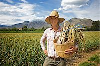 farmhand (female) - Portrait of Farmer Holding Basket on Organic Farm Stock Photo - Premium Rights-Managednull, Code: 700-05602726