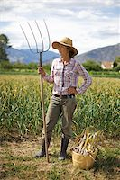 farmhand (female) - Farmer Holding Pitchfork on Organic Farm Stock Photo - Premium Rights-Managednull, Code: 700-05602728