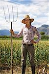 Portrait of Farmer Holding Pitchfork on Organic Farm Stock Photo - Premium Rights-Managed, Artist: Ron Fehling, Code: 700-05602730
