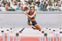Female Runner Hurdling Stock Photo - Premium Royalty-Freenull, Code: 622-05602831
