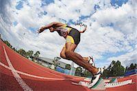 runner (male) - Runner Starting Off At Starting Block Stock Photo - Premium Royalty-Freenull, Code: 622-05602891