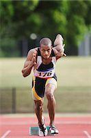 sprint - Athlete Sprinting From Starting Blocks Stock Photo - Premium Royalty-Freenull, Code: 622-05602907