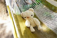 Teddy bear on hammock Stock Photo - Premium Royalty-Freenull, Code: 6106-05603212