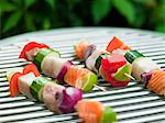 Fish and vegetable skewer in barbecue grill, close-up Stock Photo - Premium Royalty-Free, Artist: Edward Pond, Code: 6102-05603750