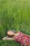 Young woman napping in tall grass Stock Photo - Premium Royalty-Free, Artist: ableimages, Code: 632-05603819