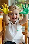 Little girl with paint on her hands Stock Photo - Premium Royalty-Freenull, Code: 632-05604112
