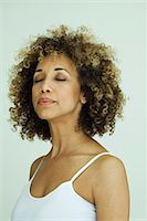 Woman with eyes closed, portrait Stock Photo - Premium Royalty-Freenull, Code: 632-05604124
