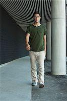 Man walking in outdoor corridor Stock Photo - Premium Royalty-Freenull, Code: 632-05604236