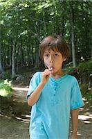 sucking - Young boy eating lollipop, portrait Stock Photo - Premium Royalty-Freenull, Code: 632-05604281