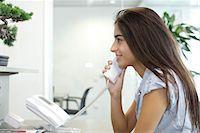 switchboard operator - Woman talking on landline telephone Stock Photo - Premium Royalty-Freenull, Code: 632-05604423