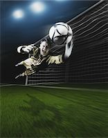 Young Goal Keeper Making a Save Stock Photo - Premium Rights-Managednull, Code: 858-05604665