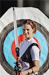 Young Female Archer Smiling Before a Bull's Eye Target Stock Photo - Premium Rights-Managed, Artist: Aflo Sport, Code: 858-05604898