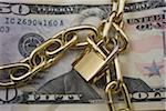 Brass lock and chain wrapped around US dollar Stock Photo - Premium Royalty-Free, Artist: Westend61, Code: 618-05605325