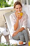 Mature woman enjoying orange juice and crossant Stock Photo - Premium Rights-Managed, Artist: urbanlip.com, Code: 847-05606879