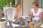 Two mature women enjoying croissant and juice Stock Photo - Premium Rights-Managed, Artist: urbanlip.com, Code: 847-05606883
