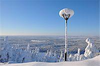 Snow Covered Street Light overlooking Forest, Rukatunturi, Kuusamo, Northern Ostrobothnia, Finland Stock Photo - Premium Royalty-Freenull, Code: 600-05610036