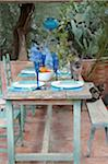 Laid table on a terrace Stock Photo - Premium Royalty-Free, Artist: Cultura RM, Code: 689-05610339