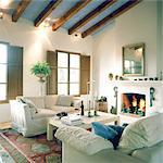 Living room with fireplace Stock Photo - Premium Royalty-Freenull, Code: 689-05610373