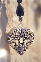 Necklace with heart-shaped pendant Stock Photo - Premium Royalty-Freenull, Code: 689-05610559