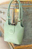 Green handbag hanging at sideboard Stock Photo - Premium Royalty-Freenull, Code: 689-05610678