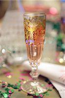 Champagne glass and confetti Stock Photo - Premium Royalty-Freenull, Code: 689-05610825
