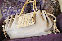 Handbag on couch Stock Photo - Premium Royalty-Freenull, Code: 689-05610915