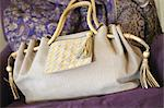 Handbag on couch Stock Photo - Premium Royalty-Free, Artist: Frank Krahmer, Code: 689-05610915