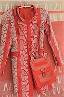 Coat and shoulder bag on coat hanger Stock Photo - Premium Royalty-Freenull, Code: 689-05610961