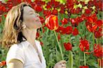 Woman surrounded by red tulips Stock Photo - Premium Royalty-Free, Artist: AlaskaStock, Code: 689-05611146
