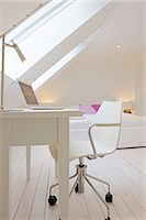 flat - Attic flat with bed and working area Stock Photo - Premium Royalty-Freenull, Code: 689-05611267