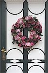 Flower wreath at front door Stock Photo - Premium Royalty-Freenull, Code: 689-05611297