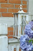 Hydrangea and lantern in front of timber-framed house Stock Photo - Premium Royalty-Freenull, Code: 689-05611397
