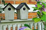 Two birdhouses on fence Stock Photo - Premium Royalty-Free, Artist: F1Online, Code: 689-05611398