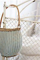Handbag hanging at bedpost Stock Photo - Premium Royalty-Freenull, Code: 689-05611466