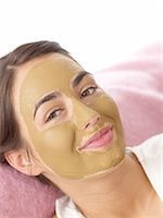 facial - Young woman with healing earth face mask Stock Photo - Premium Royalty-Freenull, Code: 689-05611539